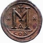 The coin's reverse. The M refers to its value (40 nummi); CON is its mint (Constantinople). The A refers to the workshop in which the coin was minted. The stars and cross are probably quality assurance symbols.