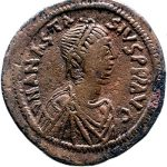A bronze follis of emperor Anastasius I (497-517). The emperor's name can be read around his portrait.